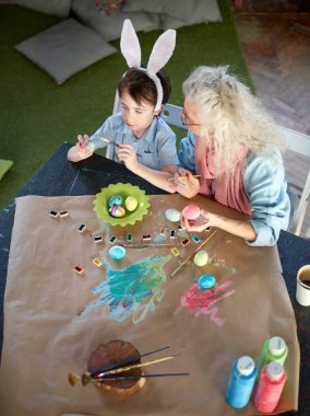 Grey-haired granny and grandson