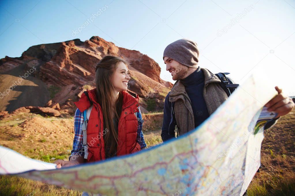 adventurers holding huge map
