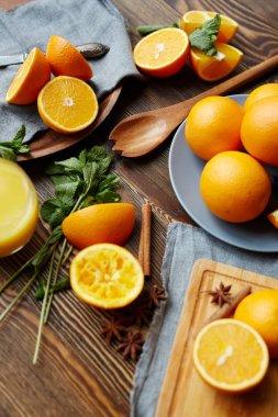 ripe oranges cut in half, mint, cinnamon