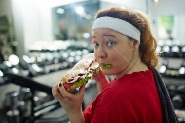 woman eating huge sandwich