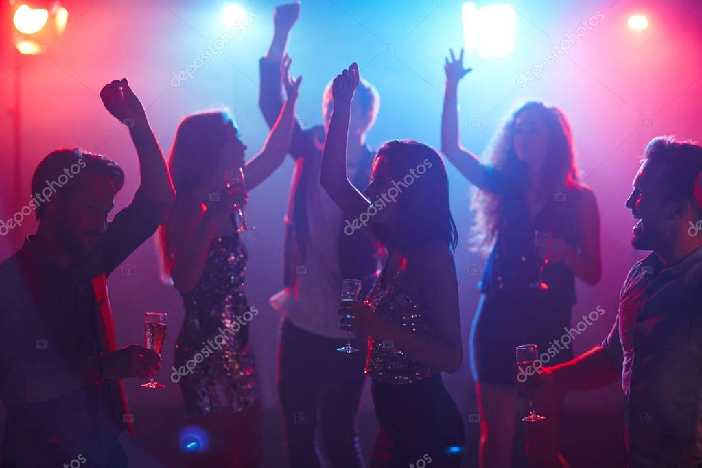 Students dancing in club
