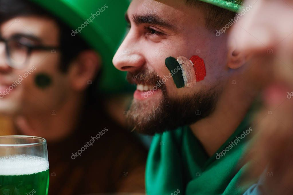 Smiley guy with flag on cheek