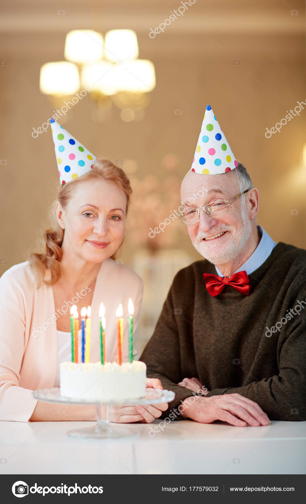 Mature Spouses Birthday Cake Looking Camera Stock Photo