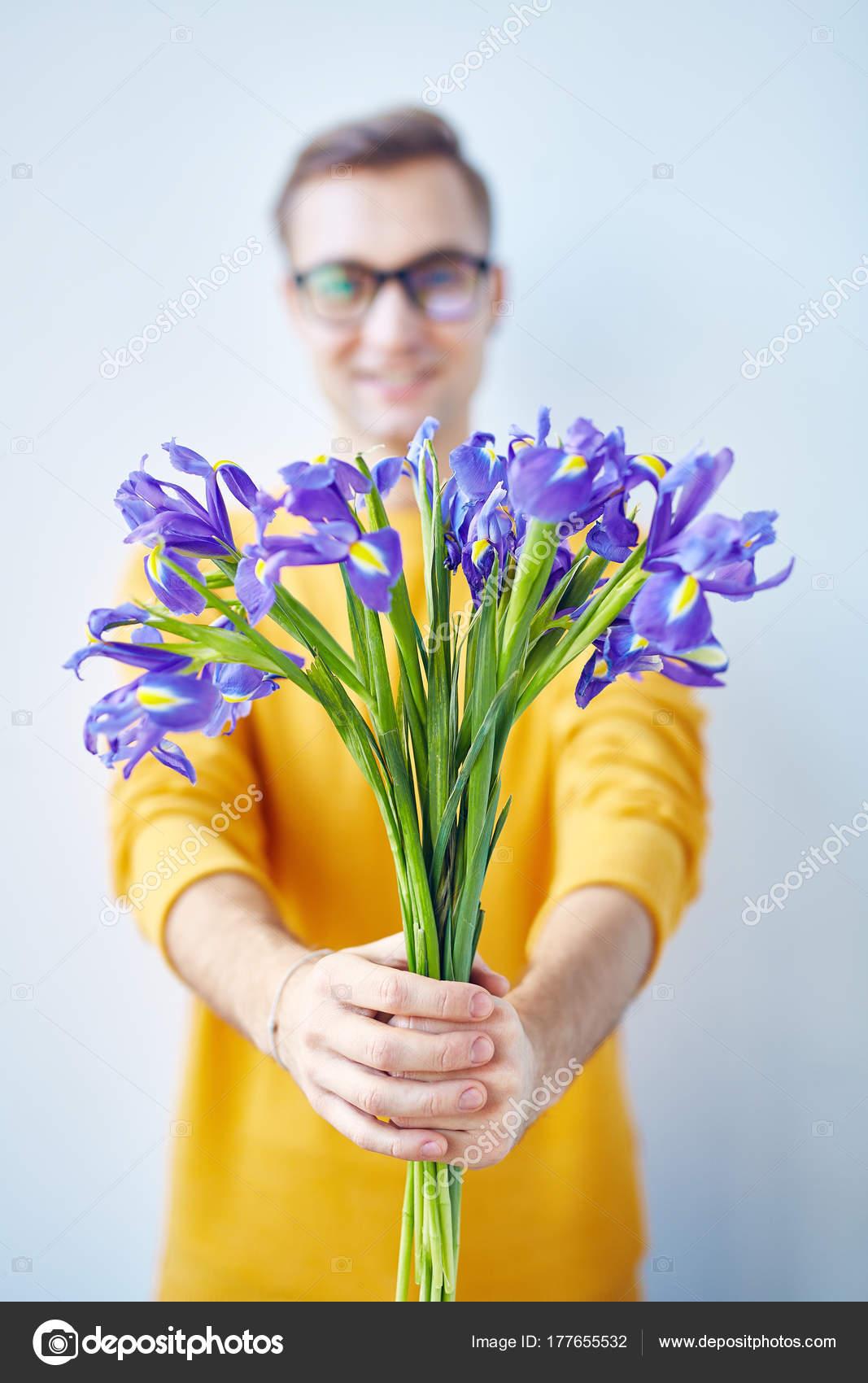 Portrait Smiling Young Man Handing Bouquet Flowers Camera Focus ...