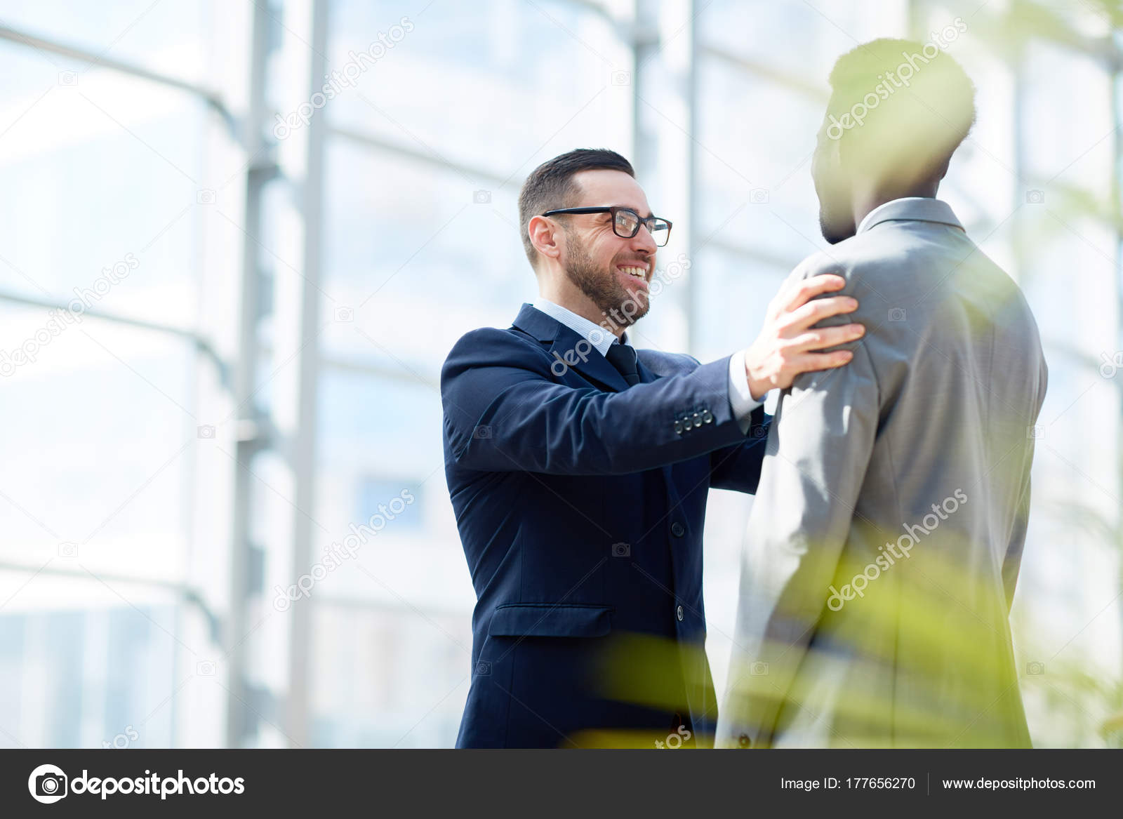 Patting someone on the shoulder