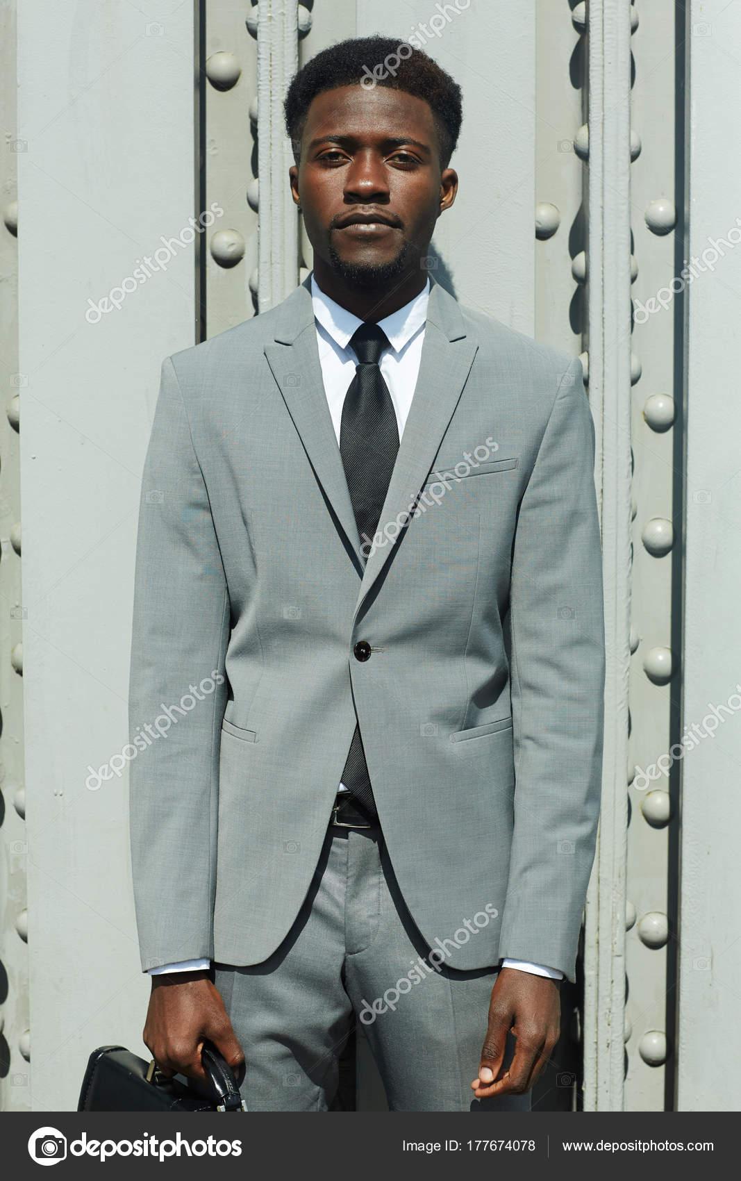 Serious Man Grey Suit Looking Camera — Stock Photo © pressmaster ...