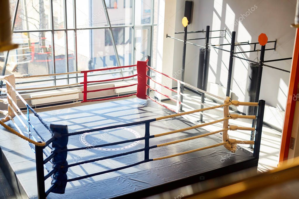 Getting High Angle Shot Of Empty Boxing Ring In Sunlit Fight Club Hall