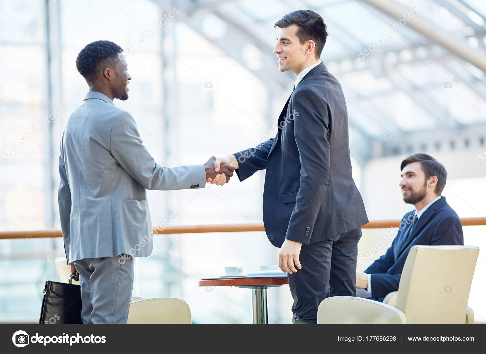 Portrait Smiling Successful Businessman Greeting African American