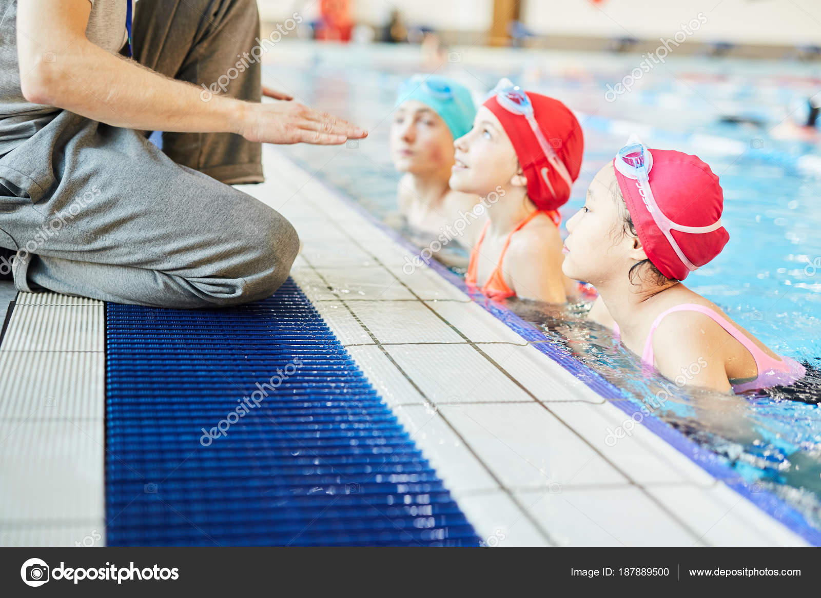 Swimming instructor gives his student a l
