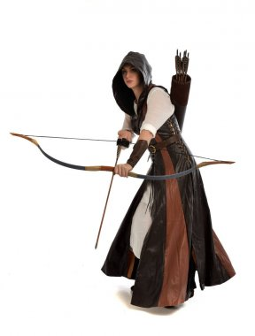 Full length portrait of woman wearing brown medieval fantasy outfit, with a bow and arrow. standing pose on white studio background. stock vector