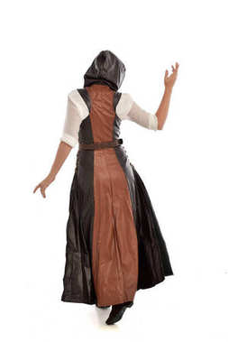 full length portrait of blonde girl wearing  brown leather fantasy outfit, standing pose with the back to the camera. isolated on white studio background.