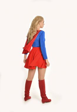 full length portrait of pretty girl wearing super hero costume, standing pose, isolated on white studio background.