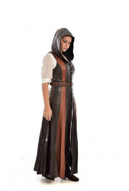 full length portrait of girl wearing brown leather medieval costume, standing pose, isolated on white studio background.