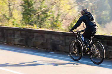 Fiesole, Italy 04 02 2018: cyclist training uphill