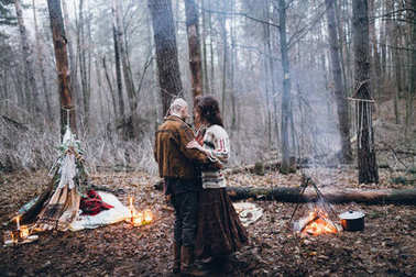 young  guy with his beloved girl dancing  in the forest