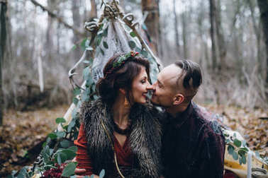 Handsome guy with his beloved girl in the forest