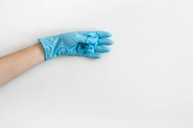 Hand with medical rubber gloves