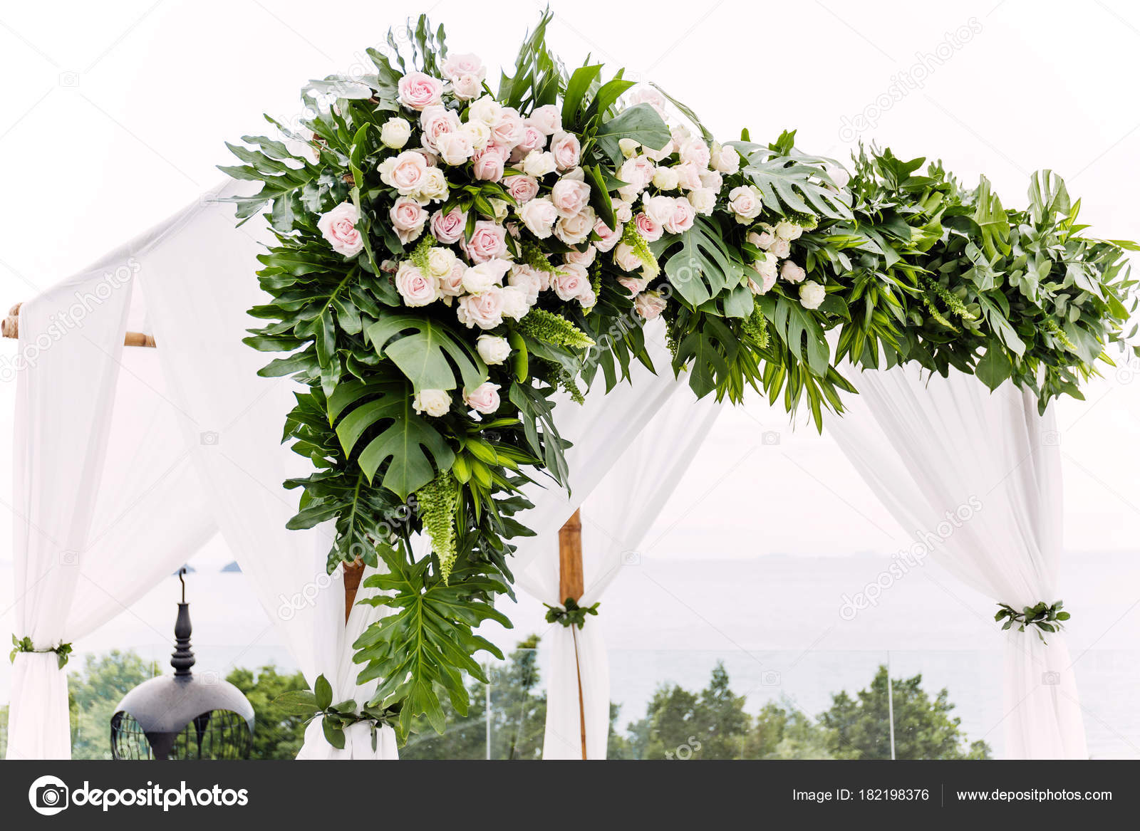 White wedding arch decorated flowers floral stock photo mrseksan white wedding arch decorated flowers floral stock photo junglespirit