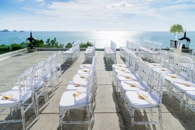 Wedding banquet chairs in white, the transparent chairs. sunset