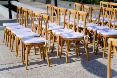 Folding Lawn Chair with white seat during wedding venue preparation, Samui island, Thailand