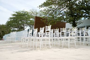 White wood chiavari banqueting chair for wedding line up on the beach, Fan souvenir, Elegant style, Aisle, Flower, Floral, Cone of roses petals