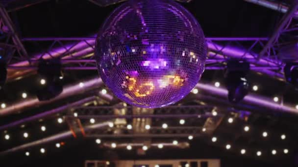Round disco ball shimmering at night