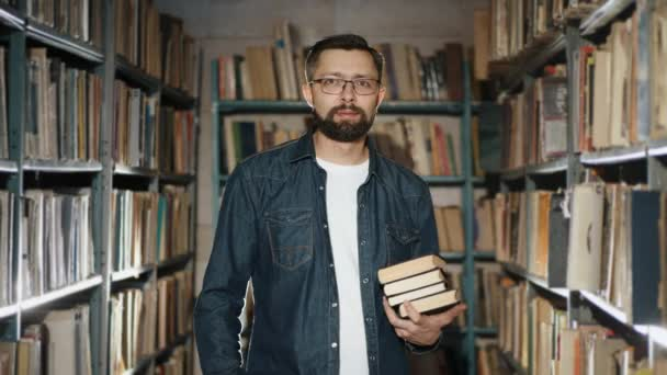 Portrait of a man with books in the library