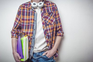 Student. Hipster. Young man with books.
