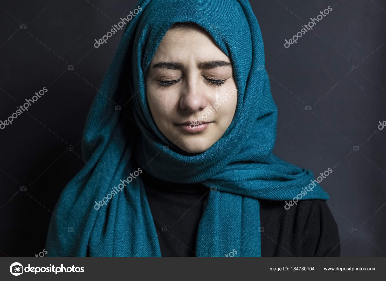 Portrait of a muslim girl with tears in her eyes stock image