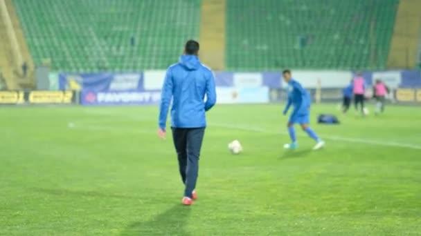 Training of a professional football team in a big stadium. Defocus effect. Football ,Soccer