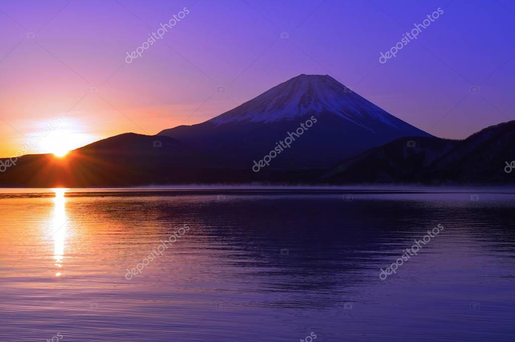 Mount Fuji and Sunrise of the morning glow from Lake Motosu Japan 02/05/2018