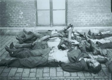 Corpse of dead victims laying at sidewalk