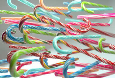 3d rendering of bunch falling candy canes. Perspective angle view with depth of field.  Christmas and New Year ornaments. Color and shape variations. Flying in zero gravity sugar sticks.