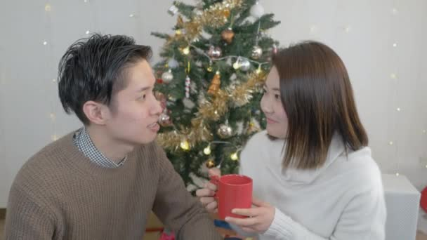 cute couple enjoying time christmas tree stock video