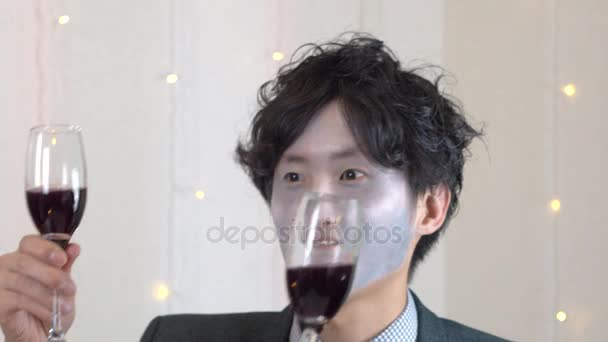 Japanese man toasting with friends Halloween Party