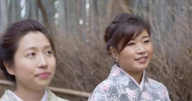 Cute Japanese women in bamboo forest Kyoto
