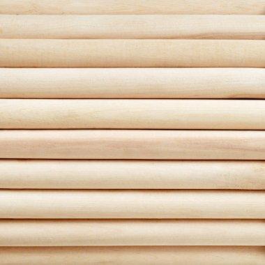 Light cylinder wooden background.