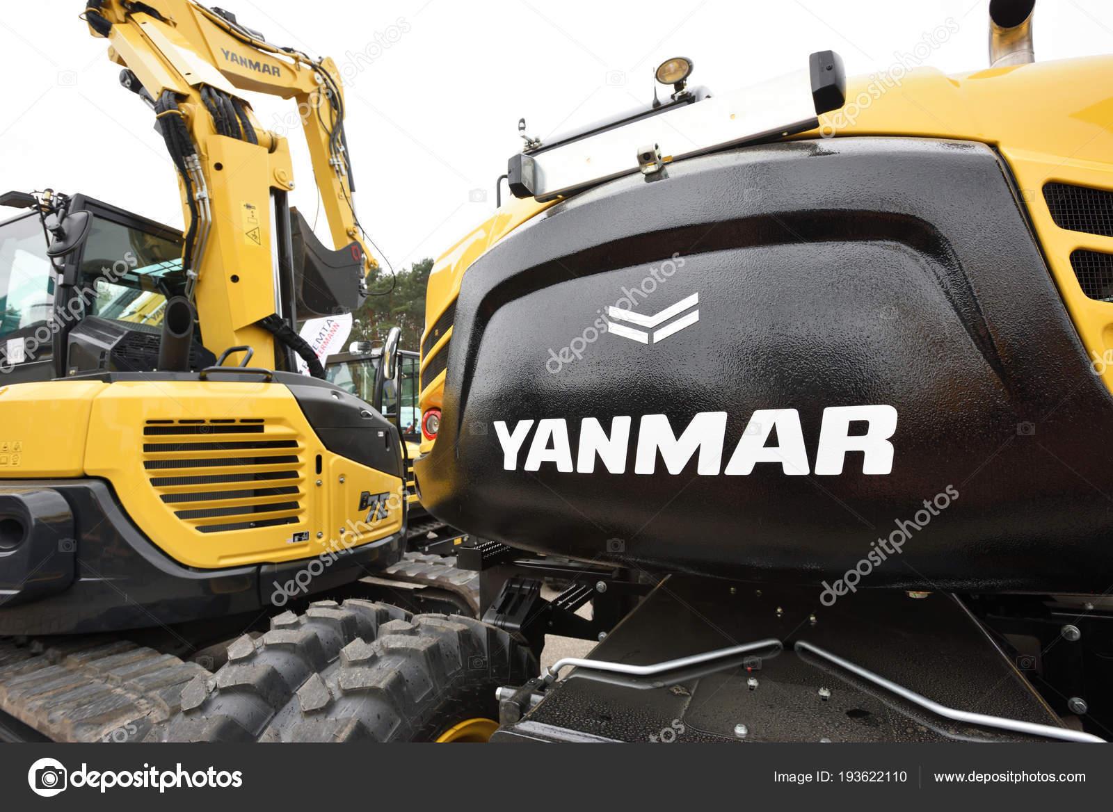 Yanmar excavator and logo – Stock Editorial Photo © _fla