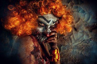 frightening clown. Halloween. Horror.