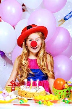 carnival birthday. Cute happy child girl .