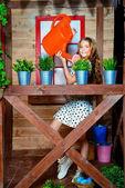 Fotografie Kind Mädchen Bewässerung Blumen
