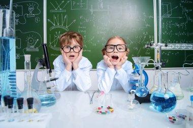 puzzled children scientists