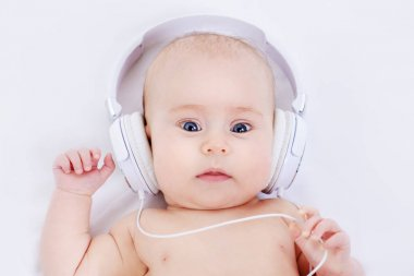 infant baby in headphones