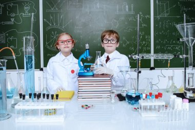 Two children scientists making experiments in the laboratory. Educational concept. Early development of children. stock vector