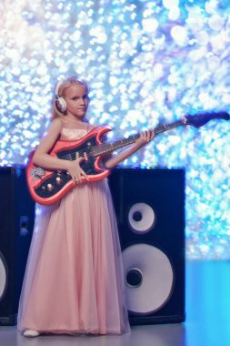 little lady and rock guitar