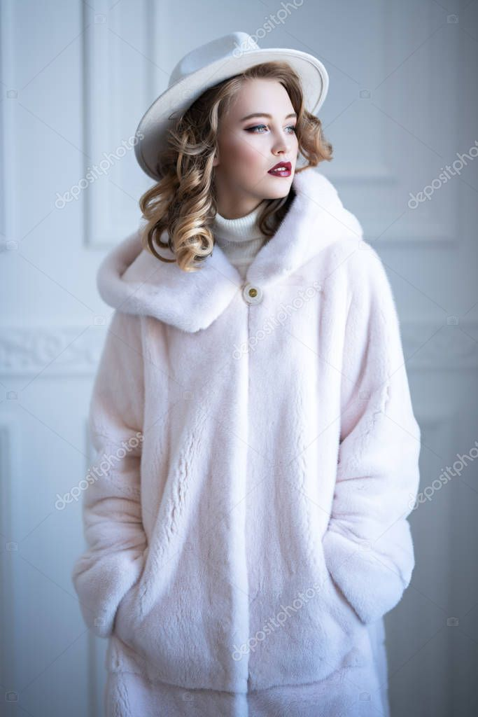 Portrait of a beautiful woman wearing a fur coat and a hat. Beauty, winter fashion, style. stock vector