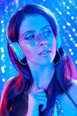 DJ girl in headphones