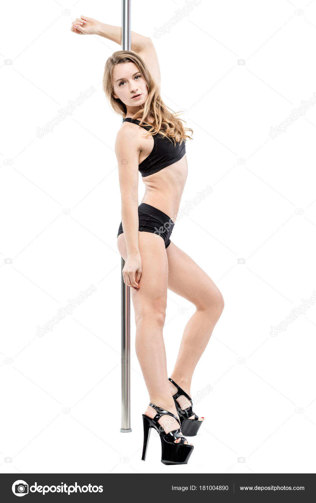 Sexy dancer girl on a pylon on heels and in lingerie on a white — Stock