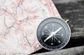 Fotografie Kompas a mapu. Cestovní koncept