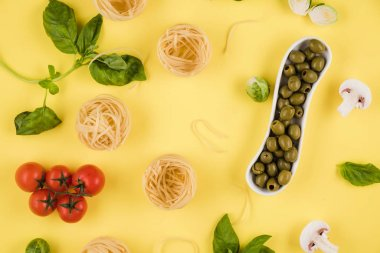 Pasta, basil, olives. Background of products. Top view.